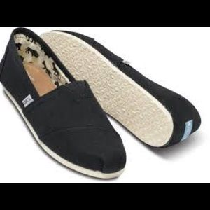 Toms black canvas with cream soles!
